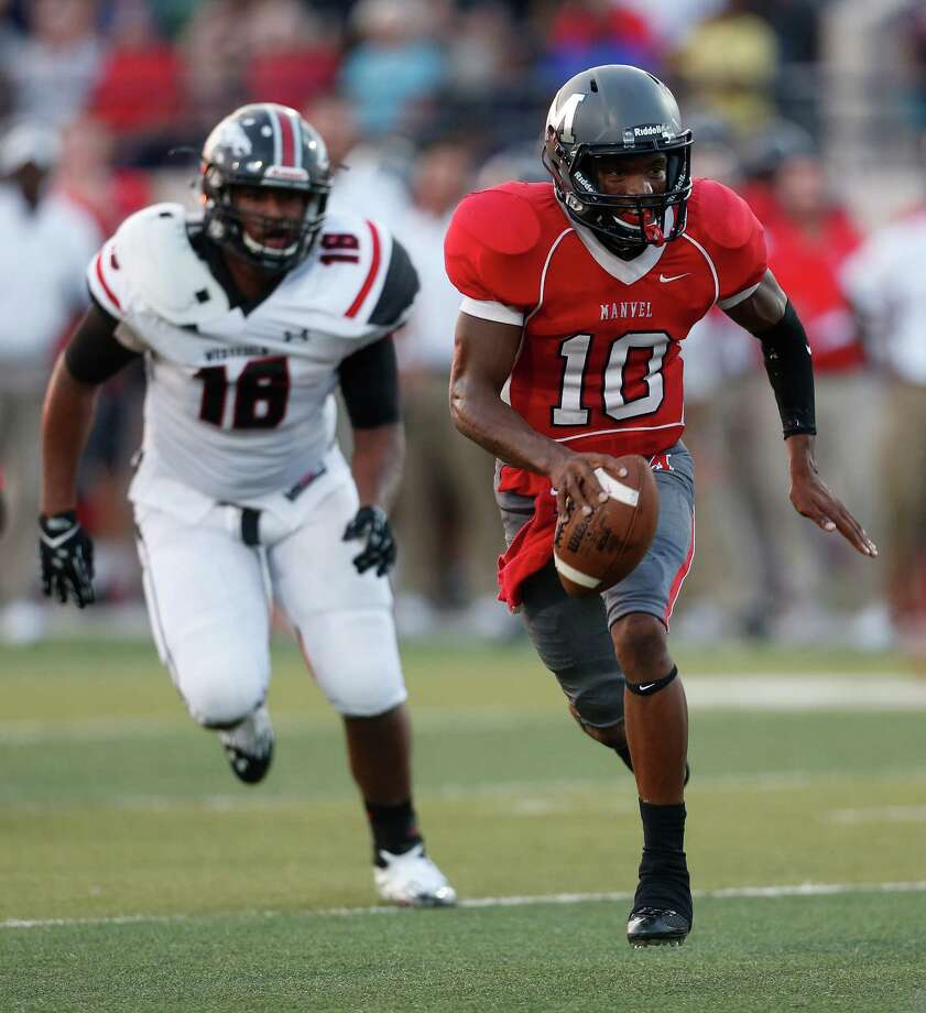 Manvel's QB D'Eriq King (10) runs against Westfield's Careen Rose (18)  during the first half of the Westfield vs Manvel High School football game on Friday, Aug. 28, 2015, in Alvin. Photo: Karen Warren, Houston Chronicle / © 2015 Houston Chronicle