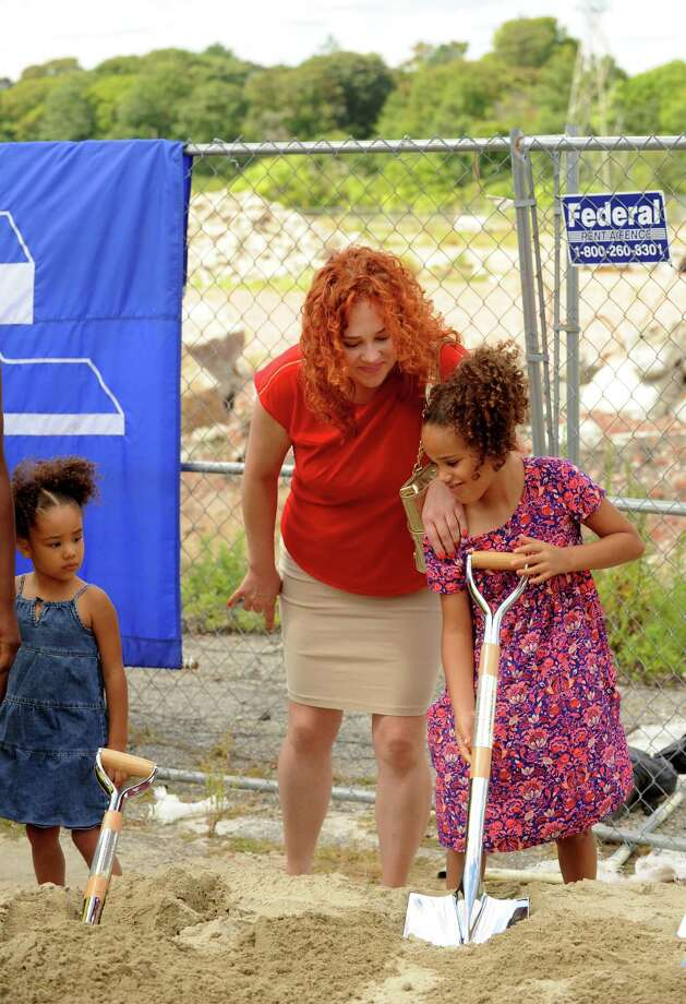 New board of education member Kate Rivera and her daughters, Angel, age 3, and Kalani, age 7, take part in the groundbreaking celebration for the new high school to replace Harding in Bridgeport, Conn. on Friday, Aug. 28, 2015.  Rivera was sworn in Thursday to a temporary seat on the city school board to fill a seat left vacant by Jacqueline Kelleher, who resigned in July. Photo: Cathy Zuraw / Hearst Connecticut Media / Connecticut Post