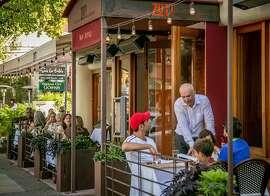 People eat dinner outside at Zut in Berkeley, Calif., on Thursday, August 27th, 2015.