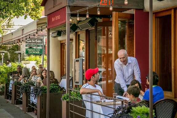 People eat dinner outside at Zut in Berkeley, Calif., on Thursday, August 27th, 2015.