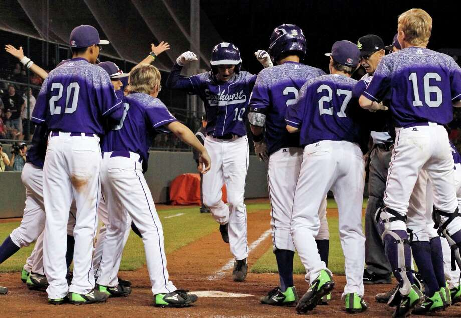 Pearland's Caleb Low, center, celebrates with teammates after hitting the game-winning, two-run home run against Bonita, Calif. Photo: Gene J. Puskar, STF / AP