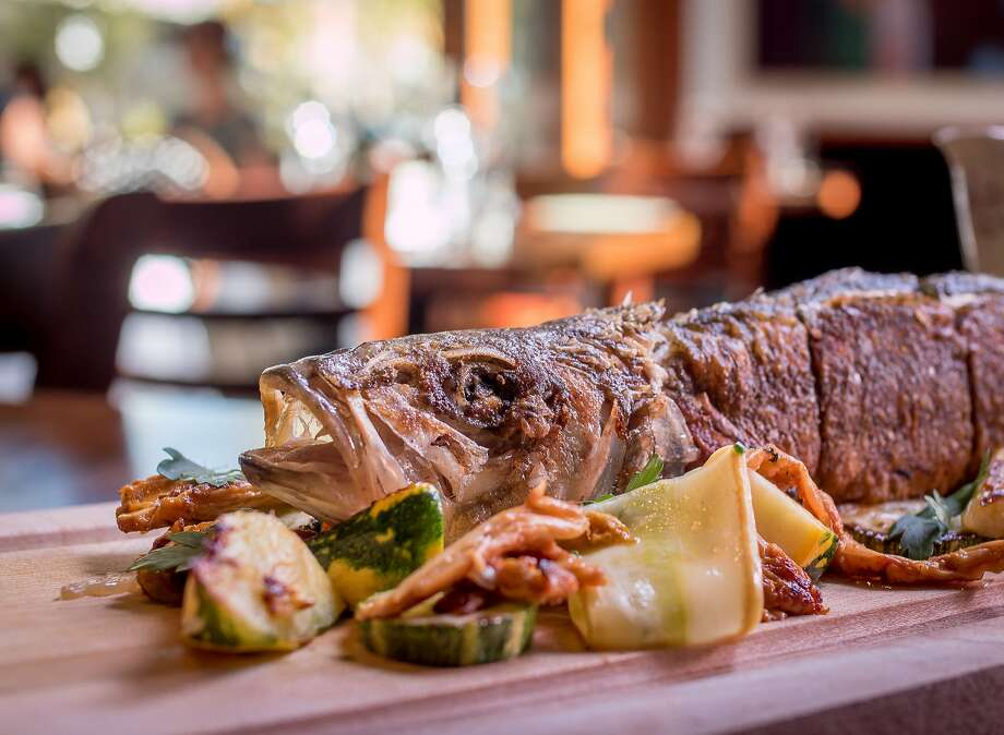 One of the most promising dishes at Zut Tavern in Berkeley is the whole roasted fish ($38). Photo: John Storey, Special To The Chronicle