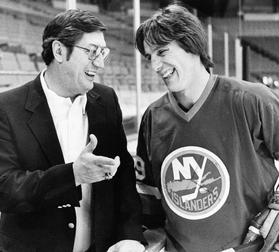 FILE - In this March 17, 1982, file photo, N.Y. Islanders coach Al Arbour, left, talks with his top scorer, Mike Bossy, during a break in practice in Denver. Arbour, who coached the New York Islanders to four consecutive Stanley Cup championships and ranks as the NHL's second-most winningest coach, has died, team officials announced Friday, Aug. 28, 2015. He was 82. The cause of death is unclear, though Arbor was battling a lengthy illness and had been living in Florida. (AP Photo/Ed Andrieski, File) ORG XMIT: NY180 Photo: Ed Andrieski / AP