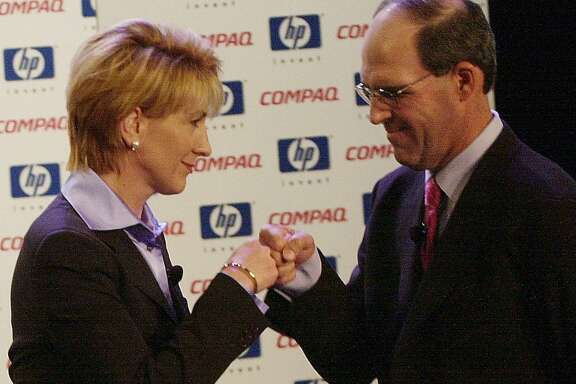 Hewlett-Packard Chairwoman and Chief Executive Carly Fiorina and Compaq's Chairman and Chief Executive Michael Capellas bump fists at the start of an investors meeting in New York Tuesday, Sept. 4, 2001. High-tech giant Hewlett-Packard Co. is buying Compaq Computer Corp. for about $25 billion. (AP Photo/Suzanne Plunkett).   DAP GREETING, BUMP FISTS, KNUCKLE BUMP   HOUCHRON CAPTION (09/05/2001):  Hewlett-Packard's Carly Fiorina bumps fists with Compaq's Michael Capellas on Tuesday.     HOUCHRON CAPTION (12/10/2001):  Hewlett-Packard chairwoman and CEO Carly Fiorina and Compaq chairman and CEO Michael Capellas bump fists after announcing a proposed merger of the two companies.  HOUCHRON CAPTION  (02/06/2002):  Carly Fiorina, Hewlett-Packard Co.'s chairwoman and CEO, bumps fists with Michael Capellas, Compaq Computer Corp.'s chairman and CEO, at an investors meeting formally announcing their proposed merger in September. Both companies are putting the merger to vote in March.     HOUCHRON CAPTION (02/10/2005)  SECBIZ COLOR: MANO A MANO: Hewlett-Packard's Carly Fiorina and Compaq's Michael Capellas bump fists in February 2002 after announcing the merger.