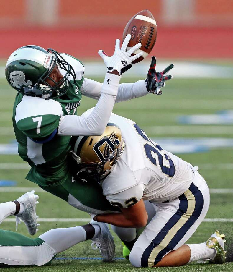 Reagan's Jamarque Washington loses control of the ball as he is hit by  O'Connor's David Gutierrez during first half action Friday Aug. 28, 2015 at Heroes Stadium. Photo: Edward A. Ornelas, Staff / San Antonio Express-News / © 2015 San Antonio Express-News