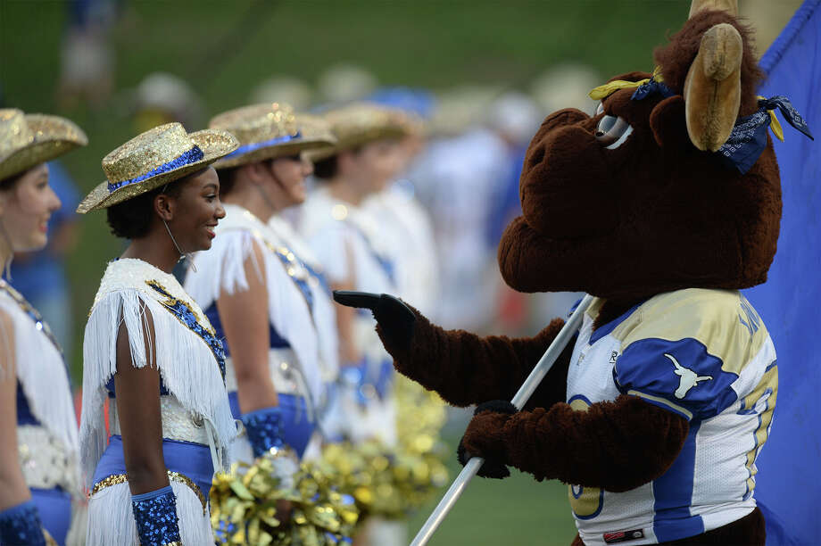 Hamshire-Fannett ISD is still in the 'exploratory phase' of considering random drug testing for all high school students involved in extracurricular activities. Pictured, a Longhorn mascot enter acts with a drill team member at Hamshire-Fannett's game against Lumberton at Lamar Stadium Friday night.