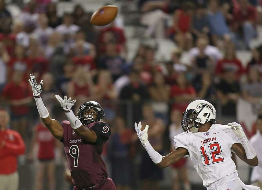 George Ranch defensive back Mikial Onu hauls in an interception of a pass just out of the reach of Dawson  wide receiver Deonte Williams, one of several big plays on defense for the Longhorns in their opening win. Photo: Thomas B. Shea, Freelance / © 2014 Thomas B. Shea