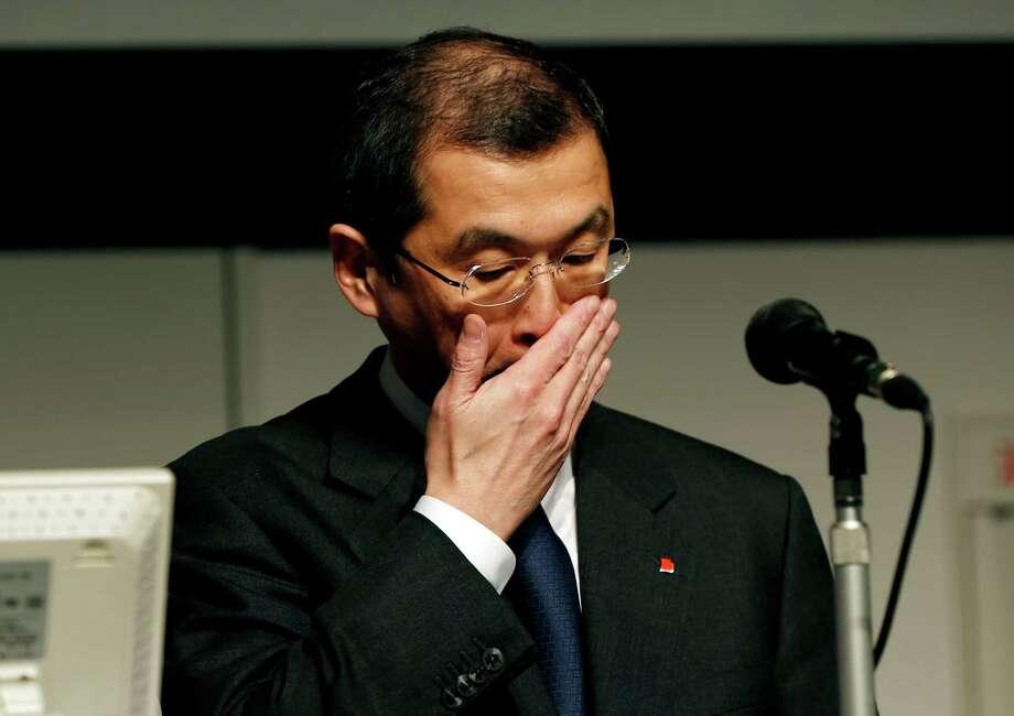 Takata CEO Shigehisa Takada holds a news conference this summer about air bag recalls. Photo: Shuji Kajiyama, STF / AP