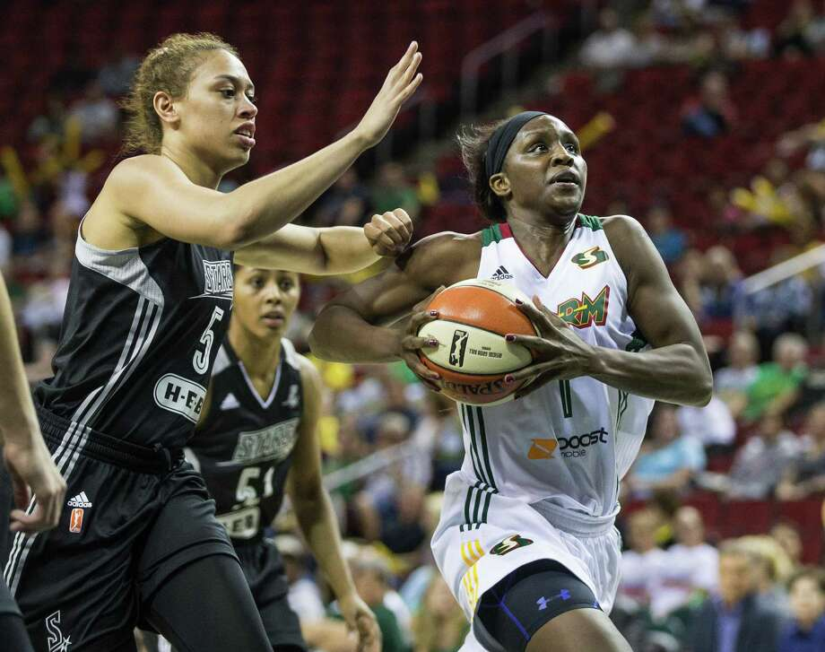 Seattle Storm's Crystal Langhorne gets position in the lane and scores on San Antonio Stars' Dearica Hamby during a WNBA basketball game Friday, Aug. 28, 2015, in Seattle.  (Dean Rutz/The Seattle Times via AP) Photo: Dean Rutz, MBR / Associated Press / The Seattle Times