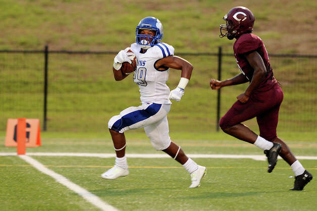 West Brook Bruin Joel Denly, 29, outruns Central Jaguar Juwan Mitchell, 8, at the Carroll Thomas Stadium August 28, 2015. Photo by Drew Loker Photo: Drew Loker / ©2015. www.DrewLoker.com