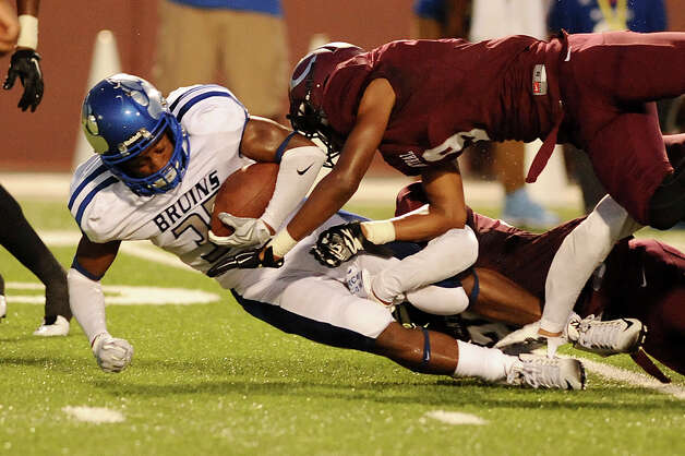 West Brook Bruin Nick Sorrell, 35, is taken down by several Central Jaguars at the Carroll Thomas Stadium August 28, 2015. Photo by Drew Loker Photo: Drew Loker / ©2015. www.DrewLoker.com