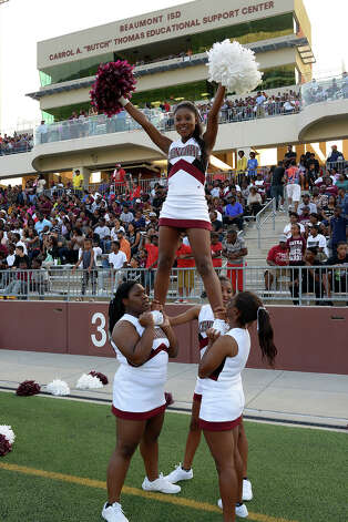 Central Jaguar cheerleaders prepare to take on the West Brook Bruins at the Carroll Thomas Stadium August 28, 2015. Photo by Drew Loker Photo: Drew Loker / ©2015. www.DrewLoker.com