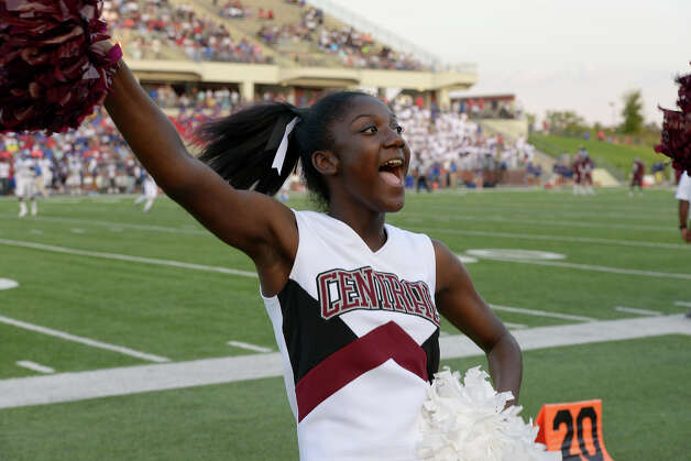 A Central Jaguar cheerleader rallies the crowd just before kickoff against the West Brook Bruins at the Carroll Thomas Stadium August 28, 2015. Photo by Drew Loker Photo: Drew Loker / ©2015. www.DrewLoker.com