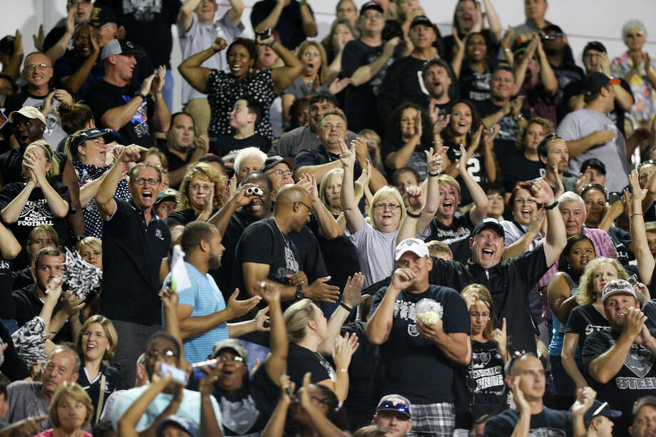 Steele fans celebrate a second quarter touchdown during their season-opening game with Madison at Lehnoff Stadium on Friday, Aug. 28, 2015.  MARVIN PFEIFFER/ mpfeiffer@express-news.net Photo: Marvin Pfeiffer, Staff / San Antonio Express-News / Express-News 2015