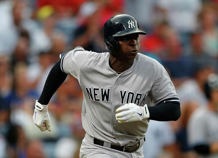 ATLANTA, GA - AUGUST 28:  Didi Gregorius #18 of the New York Yankees runs to first after hitting a three-run homer in the first inning against the Atlanta Braves at Turner Field on August 28, 2015 in Atlanta, Georgia.  (Photo by Kevin C. Cox/Getty Images) ORG XMIT: 538593081 Photo: Kevin C. Cox / 2015 Getty Images