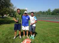 Henry DeCoster, left, won the Greenwich Town Tennis Tournament's 17-and-under singles championship Tuesday at Binney Park in Greenwich. Also pictured are tournament director Pat Cianciulli, center, and Alessio Fikre, who played DeCoster in the final.