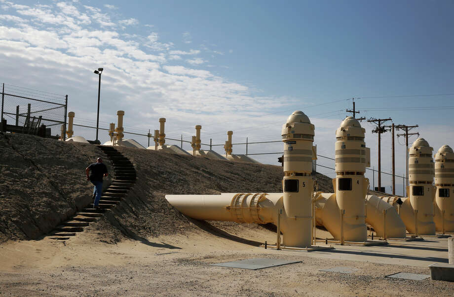 Steve Yoder jogs up steps near huge pumps at the Kern Water Bank pump station in Bakersfield. / ONLINE_YES