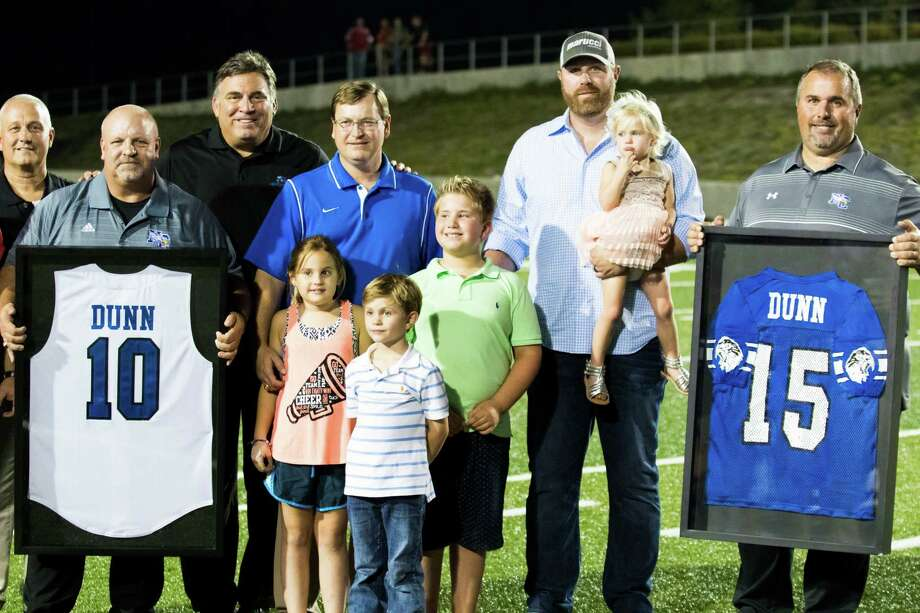 New Caney held a ceremony to retire former baseball slugger Adam Dunn's football and baseball jerseys. Dunn, second from right, played 14 MLB seasons. Photo: Joe Buvid, Freelance / © 2015 Joe Buvid