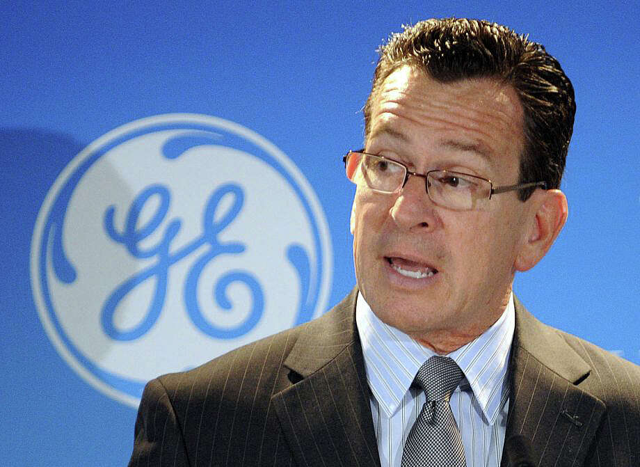 Gov. Dannel P. Malloy, in a photo from a 2012 press conference, is being asked by some state legislators to call a special leglative session to address tax issues that have prompted GE officials to say they are considering a move from its Fairfield corporate headquarters to another state. Photo: Mike Orazzi / The Bristol Press Via AP / Mike Orazzi / The Bristol Press Via AP / Fairfield Citizen