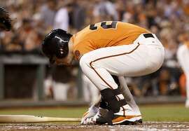 SAN FRANCISCO, CA - AUGUST 28:  Buster Posey #28 of the San Francisco Giants reacts after being hit by a pitch in the third inning against the St. Louis Cardinals at AT&T Park on August 28, 2015 in San Francisco, California.  (Photo by Ezra Shaw/Getty Images)