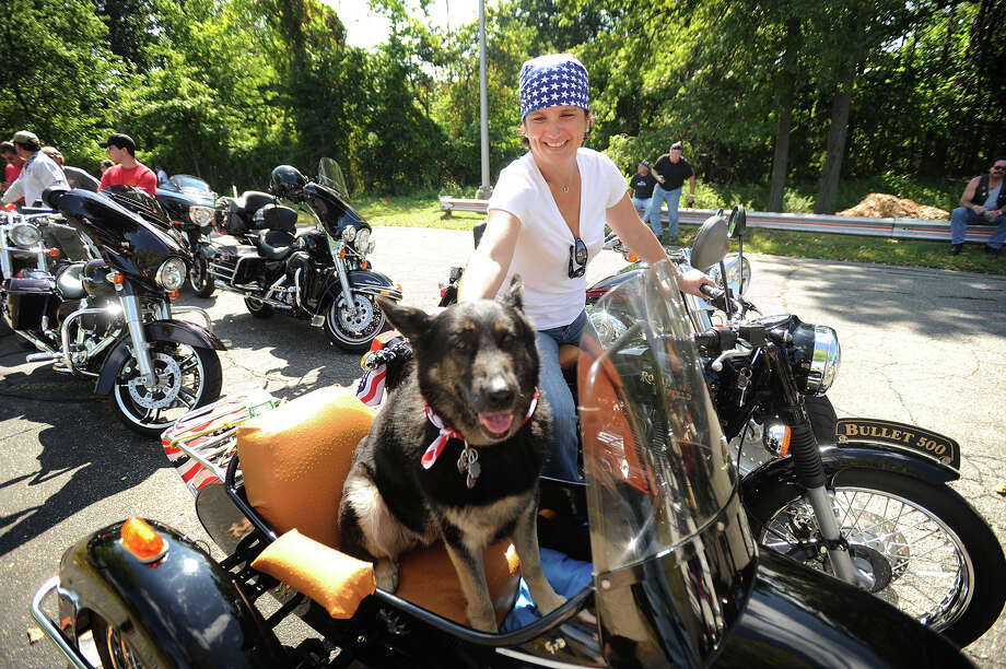 Laura Nathan, of Shelton, and dog Chili line up for the start of the 14th Annual CT United Ride motorcycle ride in Norwalk, Conn. on Sunday, September 7, 2014. Nathan used the ride to celebrate the one year anniversary of the start of her chemotherapy treatments. Nathan said she is now cancer free. Photo: Brian A. Pounds / Brian A. Pounds / Connecticut Post