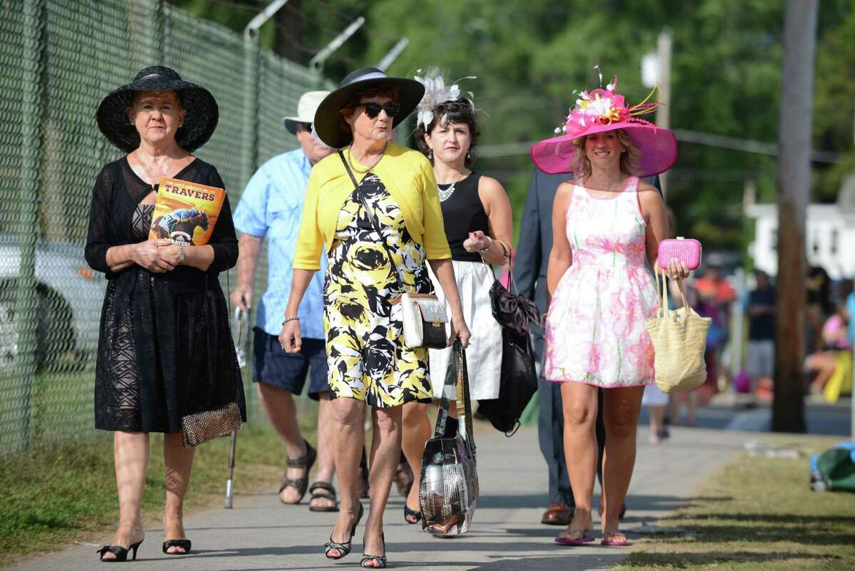 Spectators arrive at Saratoga Race Course during Travers Day Saturday morning, Aug. 29, 2015, in Saratoga Springs, N.Y. (Will Waldron/Times Union)