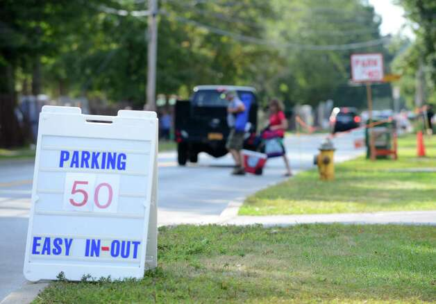 Parking fees varied at the private lots on Nelson Avenue outside Saratoga Race Course for Travers Day Saturday morning, Aug. 29, 2015, in Saratoga Springs, N.Y. (Will Waldron/Times Union) Photo: WW / 00033155B