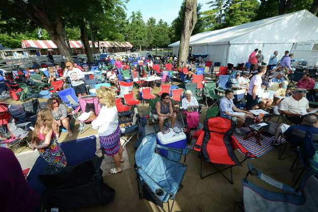 Horseracing fans arrived early to claim their spot on the grounds at Saratoga Race Course during Travers Day Saturday morning, Aug. 29, 2015, in Saratoga Springs, N.Y. (Will Waldron/Times Union) Photo: WW / 00033155B