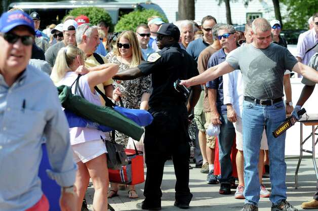 Spectators are searched at the Nelson Avenue gate before entering Saratoga Race Course during Travers Day Saturday morning, Aug. 29, 2015, in Saratoga Springs, N.Y. (Will Waldron/Times Union) Photo: WW / 00033155B