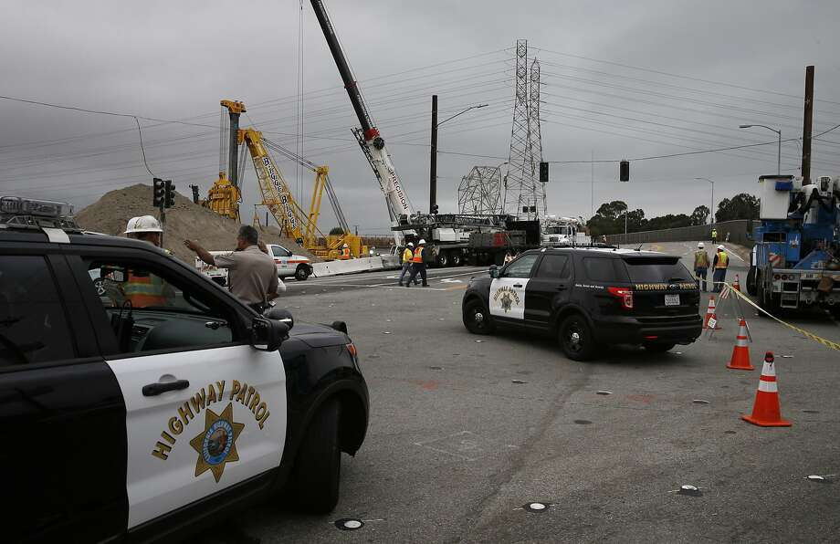 The Broadway overpass at the accident site remains shut down as repairs continue after an electrical tower was hit by a piece of construction equipment late last night shutting down highway 101 as seen in Sat. August 28, 2015, in Burlingame, Calif. Photo: Michael Macor, The Chronicle