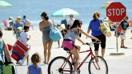 Beach-goers enjoy a day in the sun at Greenwich Point on Wednesday.