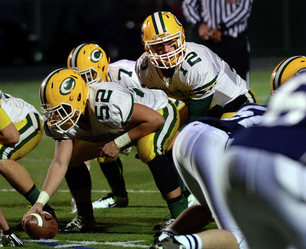 Trinity Catholic quarterback Anthony Lombardi lines up under center against Wilton last season.