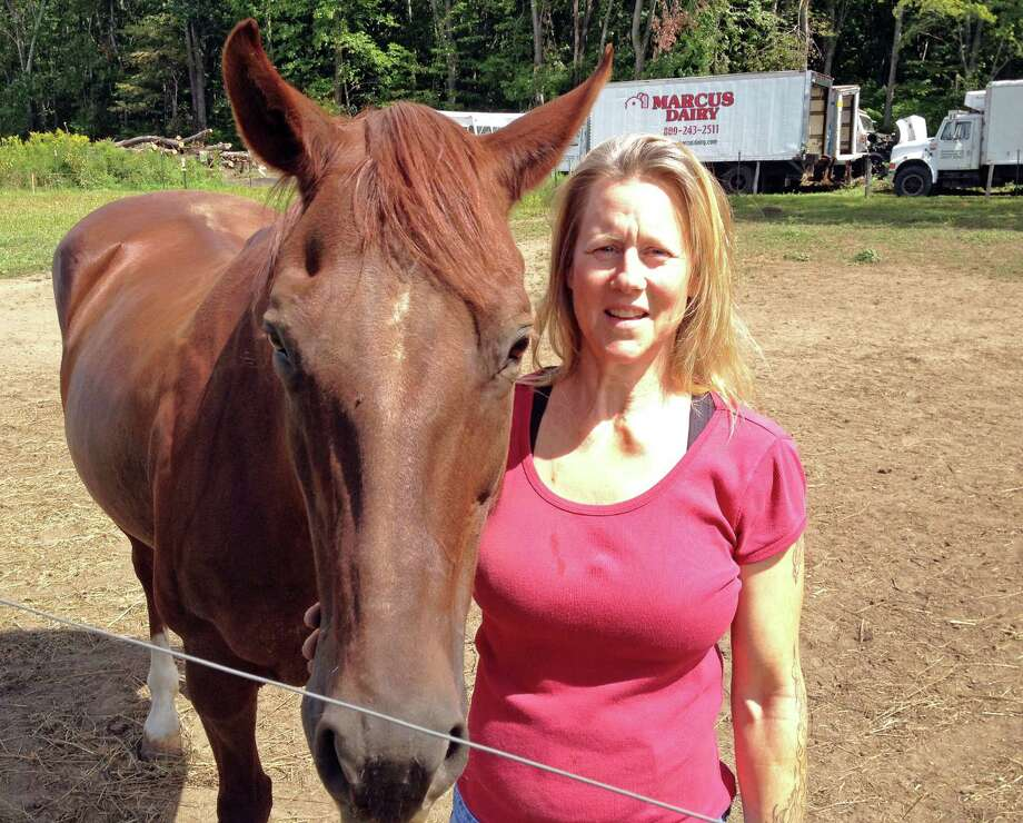 Susan Kasmin, a massage therapist for horses and humans, with Sara at her Oxford farm, where she runs a Oxford Connecticut Equine Therapy. Staff photo by Ken Dixon Photo: Ken Dixon /Staff Photo / Stamford Advocate  contributed