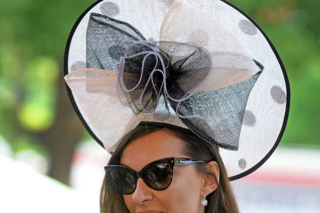 Danijela Lazarevik of New York City wears an elegant hat on Travers race day at Saratoga Race Course on Saturday Aug. 29, 2015 in Saratoga Springs, N.Y.  (Michael P. Farrell/Times Union) Photo: Michael P. Farrell / 00033156A