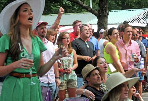 Race fans root on their pick during the sixth race on Travers race day at Saratoga Race Course on Saturday Aug. 29, 2015 in Saratoga Springs, N.Y.  (Michael P. Farrell/Times Union) Photo: Michael P. Farrell / 00033156A