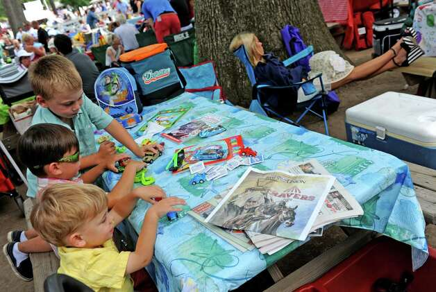 Brothers, front to back, Casey, 3, Corey,5, and Cody Gagnon,6, of Grafton, Massachusett plat cars in the picnic area on Travers race day at Saratoga Race Course on Saturday Aug. 29, 2015 in Saratoga Springs, N.Y.  (Michael P. Farrell/Times Union) Photo: Michael P. Farrell / 00033156A