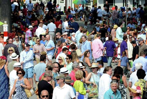 Patrons fill the grounds at Saratoga Race Course during Travers Day Saturday afternoon, Aug. 29, 2015, in Saratoga Springs, N.Y. (Will Waldron/Times Union) Photo: WW / 00033155B