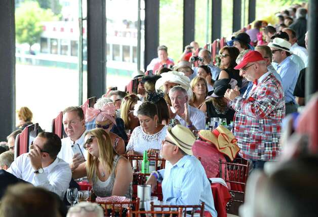 Diners at Turf Terrace enjoy a scenic lunch at Saratoga Race Course on Travers Day Saturday, Aug. 29, 2015, in Saratoga Springs, N.Y. (Will Waldron/Times Union) Photo: WW / 00033155B