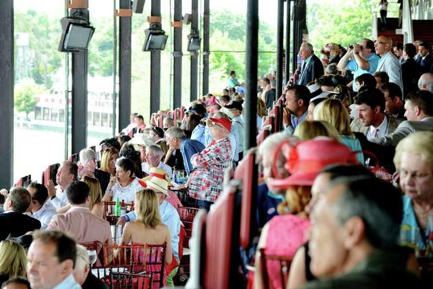Diners at Turf Terrace take in an earlier race at Saratoga Race Course on Travers Day Saturday, Aug. 29, 2015, in Saratoga Springs, N.Y. (Will Waldron/Times Union) Photo: WW / 00033155B