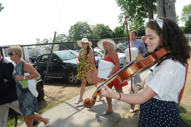 Meredith Craig of Saratoga plays the viola outside the gates on Travers race day at Saratoga Race Course on Saturday Aug. 29, 2015 in Saratoga Springs, N.Y.  (Michael P. Farrell/Times Union) Photo: Michael P. Farrell / 00033156A