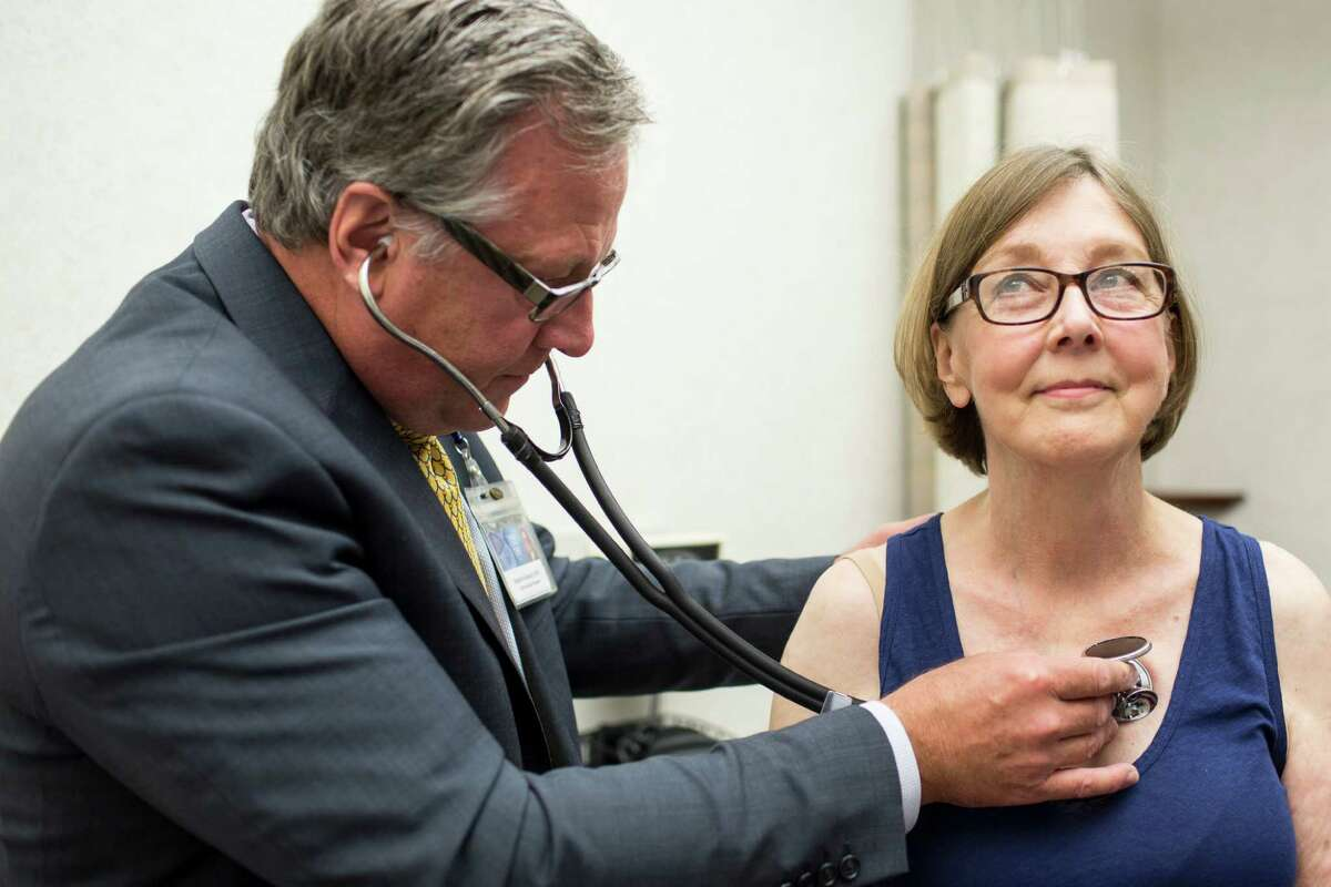 Dr. Stephen Kopecky, a cardiologist who runs the statin intolerance clinic, exams Kathryn Peterson at the Mayo Clinic in Rochester, Minn. Though statins are inexpensive and shown to have minimal side effects, doctors find it difficult to ignore complaints many patients.