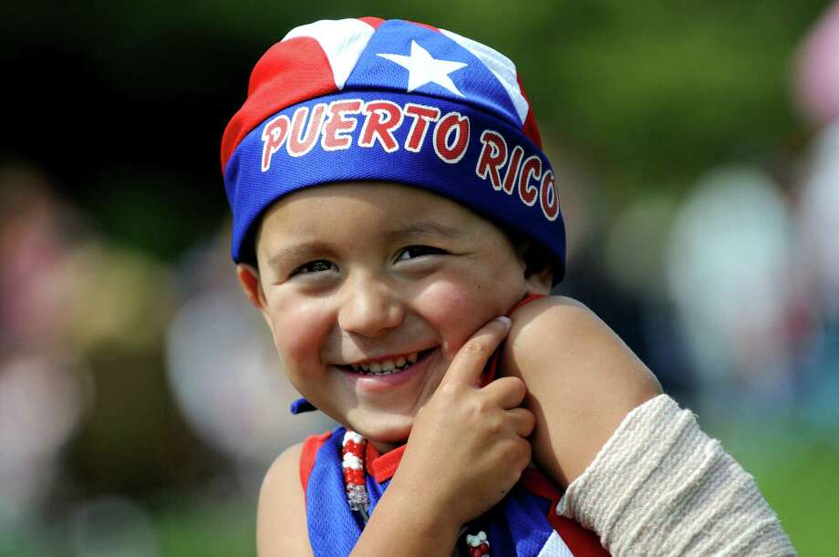 Ariel Ramos, 3, of Clifton Park celebrates his Puerto Rican heritage during the Albany LatinFest on Saturday, Aug. 29, 2015, at Washington Park in Albany, N.Y. LatinFest celebrates the Hispanic cultural heritage and the contributions made by Hispanic Americans. (Cindy Schultz / Times Union) Photo: Cindy Schultz / 00033166A