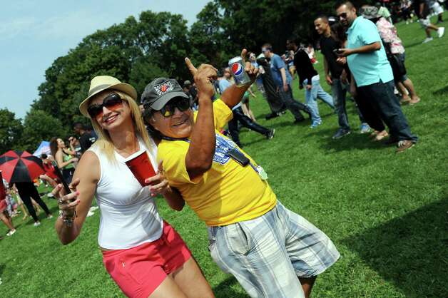 Puerto Rican native Erica Marrero of Troy, left, and Peruvian Migel Espinosa of Albany ham it up for the cameras during the Albany LatinFest on Saturday, Aug. 29, 2015, at Washington Park in Albany, N.Y. LatinFest celebrates the Hispanic cultural heritage and the contributions made by Hispanic Americans. (Cindy Schultz / Times Union) Photo: Cindy Schultz / 00033166A