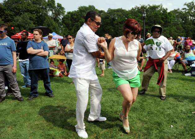 Cuban natives Carlos Acosta, left, and Betsy Charez dance to the music of Alex Torres and His Latin Orchestra during the Albany LatinFest on Saturday, Aug. 29, 2015, at Washington Park in Albany, N.Y. LatinFest celebrates the Hispanic cultural heritage and the contributions made by Hispanic Americans. (Cindy Schultz / Times Union) Photo: Cindy Schultz / 00033166A