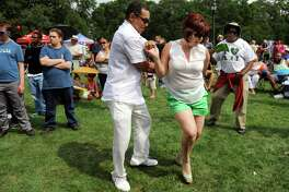 Cuban natives Carlos Acosta, left, and Betsy Charez dance to the music of Alex Torres and His Latin Orchestra during the Albany LatinFest on Saturday, Aug. 29, 2015, at Washington Park in Albany, N.Y. LatinFest celebrates the Hispanic cultural heritage and the contributions made by Hispanic Americans. (Cindy Schultz / Times Union)