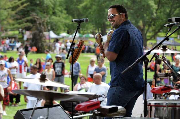 A band member of the Alex Torres and His Latin Orchestra performs during the Albany LatinFest on Saturday, Aug. 29, 2015, at Washington Park in Albany, N.Y. LatinFest celebrates the Hispanic cultural heritage and the contributions made by Hispanic Americans. (Cindy Schultz / Times Union) Photo: Cindy Schultz / 00033166A