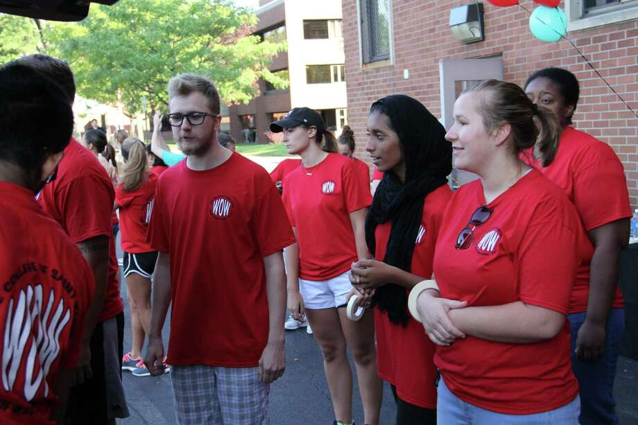 Saint Rose Arrival Assistants welcome new students and prepare to move the newcomers' belongings into the College's Lima and Brubacher residence halls.  This year, the College is welcoming 650 first-year students, the largest in its 95-year history.  Classes at Saint Rose begin Monday morning, August 31. (Courtesy College of Saint Rose)