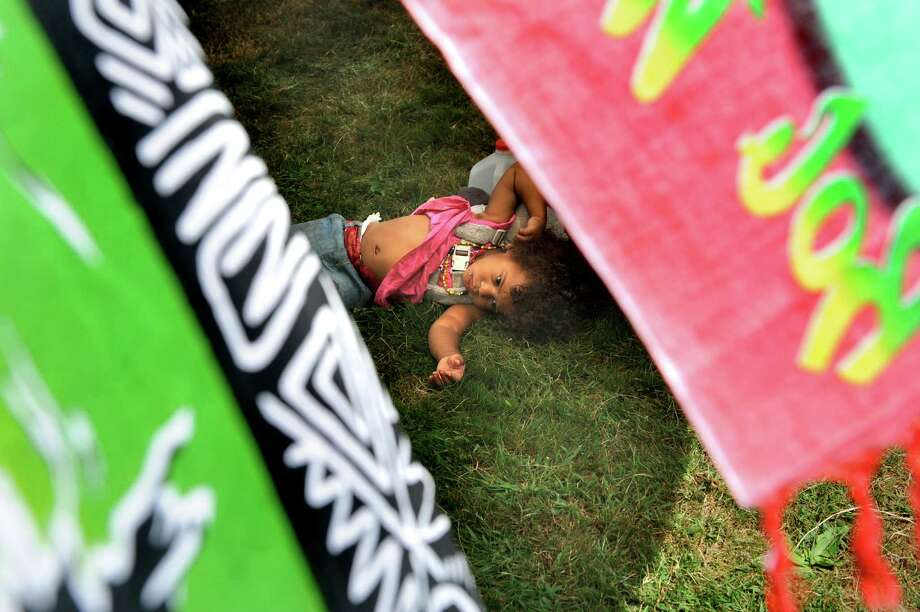 Keri Hudson, 19 months, of Brooklyn stretches out on the grass during Caribbean Day In The Park Family Fun Day on Saturday, Aug. 29, 2015, at Prospect Park in Troy , N.Y. The event celebrated Caribbean culture, cuisine and lifestyle. (Cindy Schultz / Times Union) Photo: Cindy Schultz / 00033167A