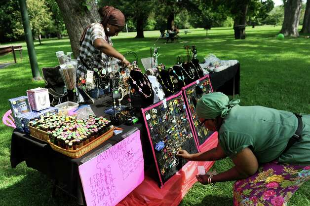 Vendors Mahdiyah Shavazz of Troy, left, and her mother Fajr Shavazz set up their jewelry and beauty products during Caribbean Day In The Park Family Fun Day on Saturday, Aug. 29, 2015, at Prospect Park in Troy , N.Y. The event celebrated Caribbean culture, cuisine and lifestyle. (Cindy Schultz / Times Union) Photo: Cindy Schultz / 00033167A