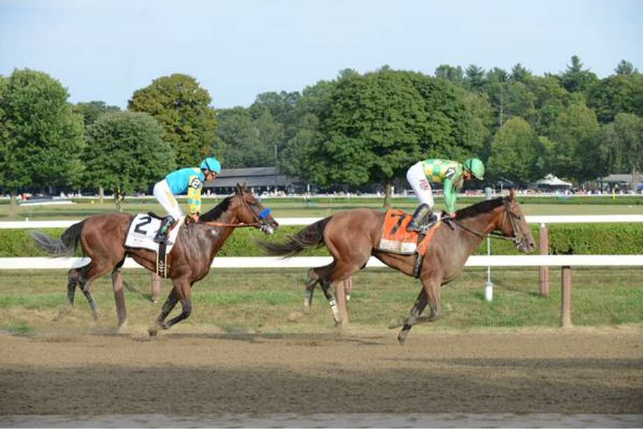 Keen Ice, right, upset American Pharoah, passing him in the stretch of the 146th Travers Stakes on Saturday at Saratoga Race Course. (Will Waldron / Times Union)